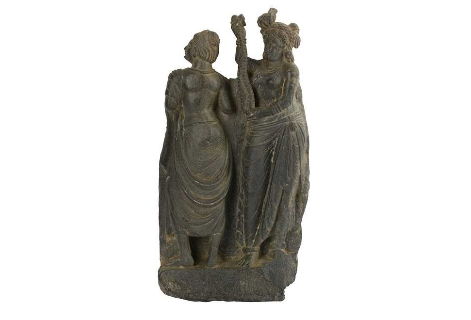 Lot 174, A Grey Schist Carving with a Standing Pair