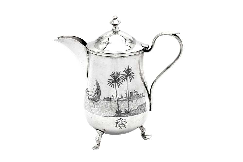 An early 20th century Iraqi silver and niello coffee pot