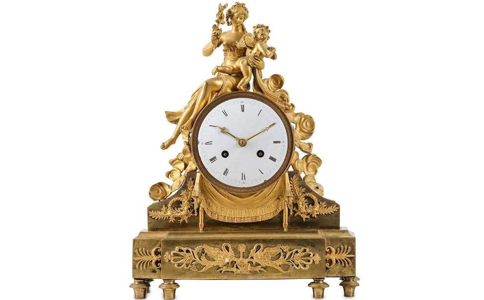 A fine and rare French empire period gilt bronze figural mantel clock depicting the punishment of cupid