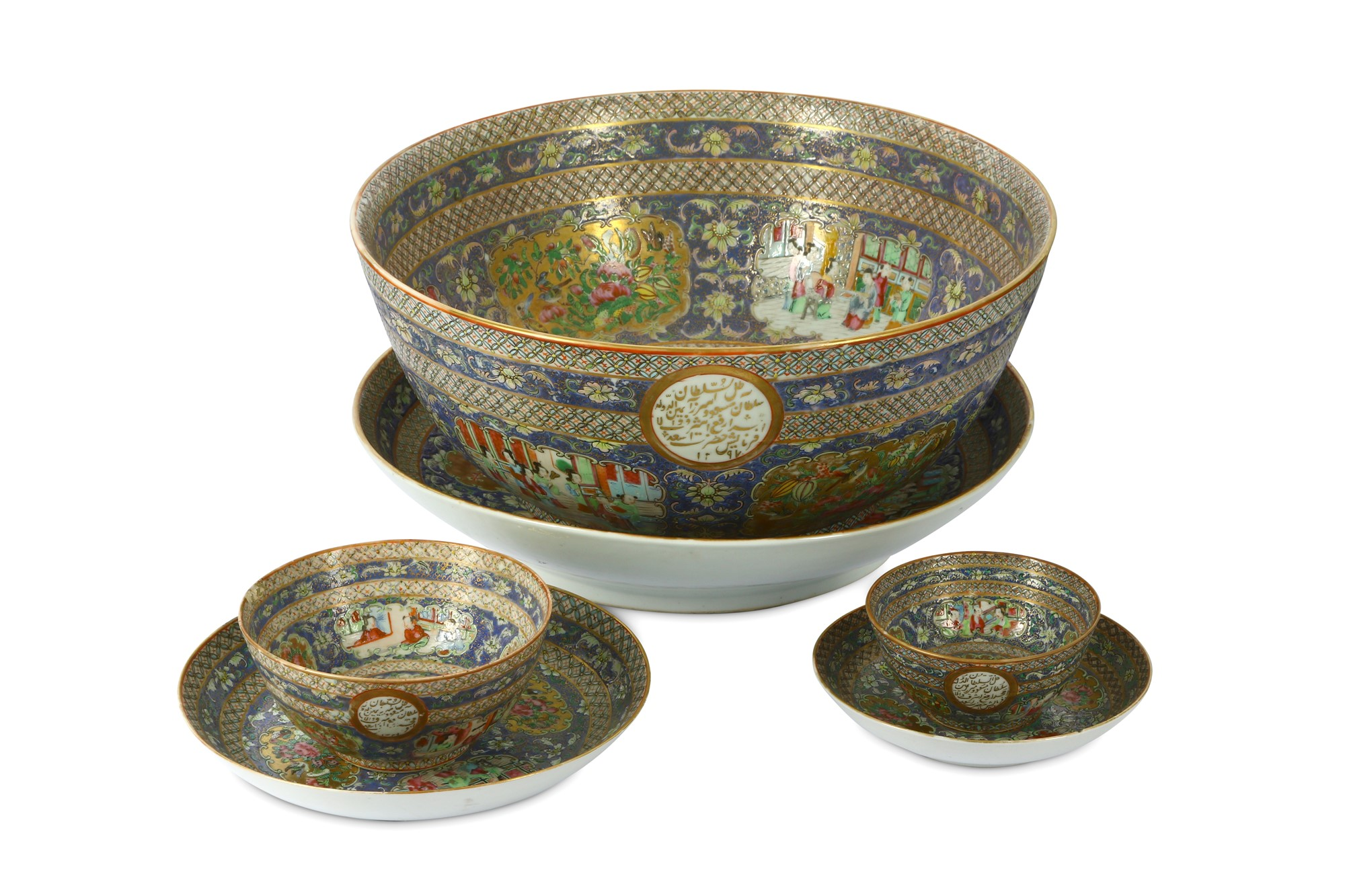 A set of three porcelain bowls and saucers with 'famille rose' decoration from the Qajar Prince Mas'ud Mirza zill al-sultan's service