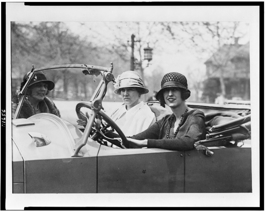 Cornelia Vanderbilt collecting her bridesmaid Augusta McCagg (centre) from the station before the wedding, 1924