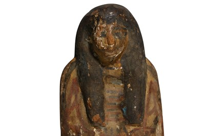 Lot 9 - AN EGYPTIAN WOOD POLYCHROME SHABTI New Kingdom,...