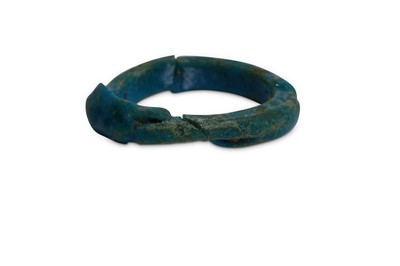 Lot 14 - AN EGYPTIAN GLAZED COMPOSITION RING Circa 1st...