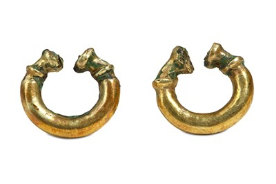 Lot 80 - A PAIR OF WESTERN ASIATIC GOLD ON BRONZE...