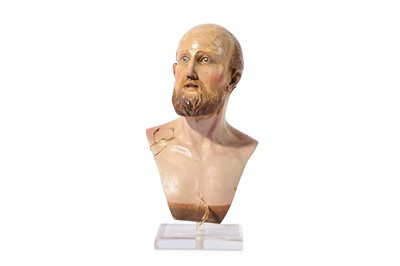 Lot 31-AN 18TH CENTURY NEAPOLITAN CARVED WOOD AND POLYCHROME DECORATED BUST OF A MAN