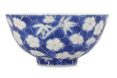 Lot 36 - A SMALL CHINESE BLUE-GROUND 'PRUNUS AND BAMBOO' CUP.