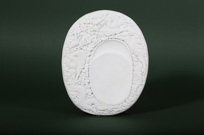 Lot 6-A CHINESE WHITE BISCUIT 'DRAGON' INKSTONE.