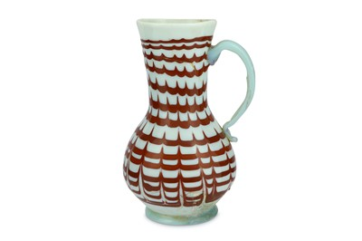 Lot 87 - A RED-ENAMELLED OPALESCENT WHITE BLOWN GLASS JUG