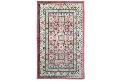 Lot 28-AN ANTIQUE SILK KHOTAN RUG, EAST TURKESTAN approx:...