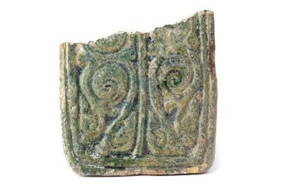 Lot 81a - A FRAGMENTARY GREEN-GLAZED POTTERY TILE WITH BIRDS AND VEGETAL ARABESQUE