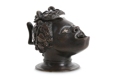 Lot 38 - A SMALL BRONZE OIL LAMP IN THE MANNER OF...