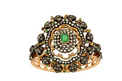 Lot 47-An emerald and diamond bangle, circa 1900 The...