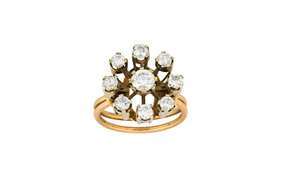 Lot 46-A diamond cluster ring The raised cluster of...