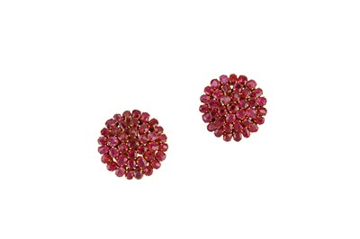Lot 37-A pair of ruby cluster earrings Each designed as...