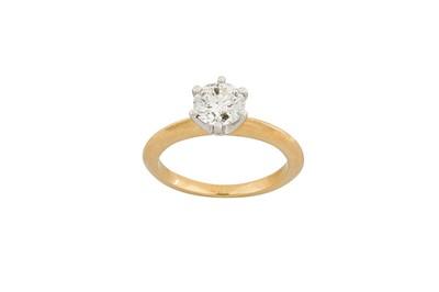Lot 36-A diamond single-stone ring The claw-set...