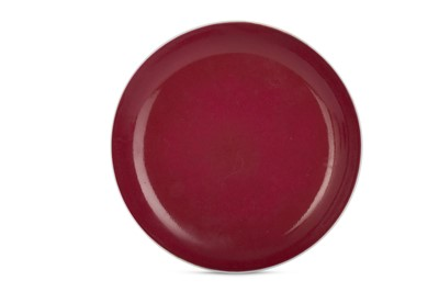Lot 33-A CHINESE RUBY-GLAZED DISH.