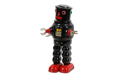 Lot 48-A TIN PLATE CLOCKWORK ROBOT BY KO JAPAN together...