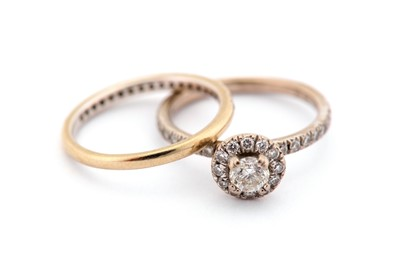 Lot 4-A diamond cluster ring and a diamond half...