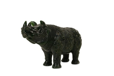 Lot 43-A CHINESE SPINACH GREEN JADE 'RHINOCEROS' CARVING.