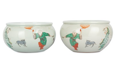 Lot 31-A PAIR OF CHINESE FAMLLE VERTE 'IMMORTALS' JARS.