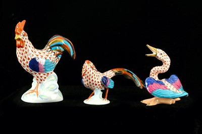 Lot 52-A group of three Herend porcelain birds each with ...