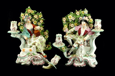 Lot 55-A pair of Derby bocage candlestick figures,...