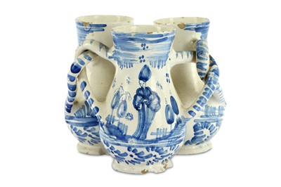 Lot 60-A German fayence blue and white fuddling cup,...