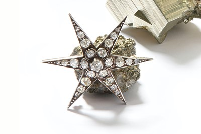 Lot 5-A late 19th/early 20th century diamond star...