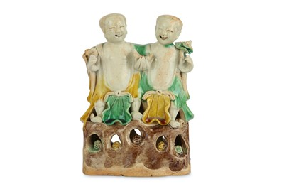 Lot 52-A CHINESE SANCAI-GLAZED BISCUIT MODEL OF THE TWINS HEHE ERXIAN.