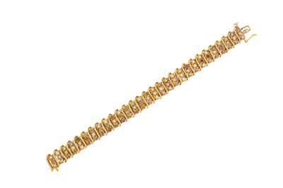 Lot 41-A diamond bracelet Composed of alternating...