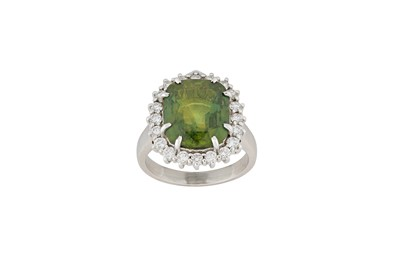 Lot 25-A green sapphire and diamond cluster ring The...