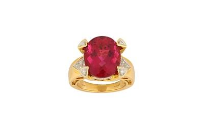 Lot 28-A pink tourmaline and diamond dress ring The oval-...