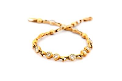 Lot 25-A fancy-link bracelet, set withimitation...