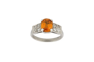 Lot 20-An orange sapphire and diamond ring The oval-cut...