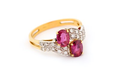 Lot 28-A garnet and diamond dress ring, of crossover...