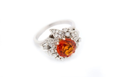 Lot 20-A citrine and diamond dress ring, the...