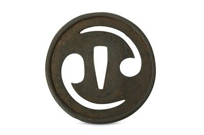 Lot 11-AN IRON TSUBA. Edo period. Of circular form,...