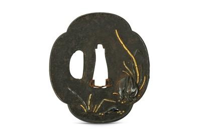 Lot 15-AN IRON TSUBA. Edo period. Of mokko form, inlaid...