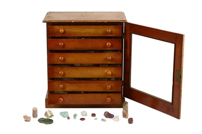 Lot 43-A collector's chest of loose gemstones and...