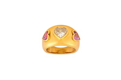 Lot 31-A pink sapphire and diamond ring Centered by a...