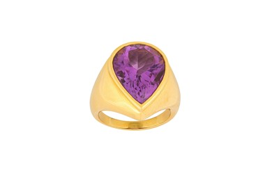 Lot 9-An amethyst ring The pear-shaped amethyst, in a...