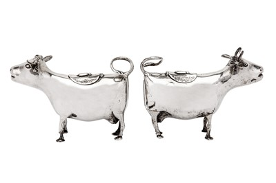 Lot 228-A matched pair of late 19th century / early 20th century German 800 standard silver cow creamers, Hanau circa 1900