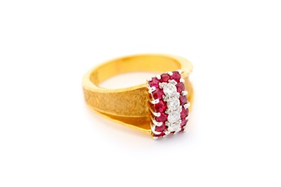 Lot 6-A ruby and diamond ring, the 18 carat gold ring...