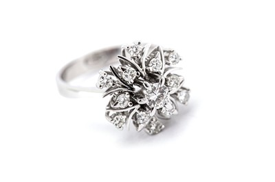 Lot 5-A diamond dress ring, set with a raised openwork...