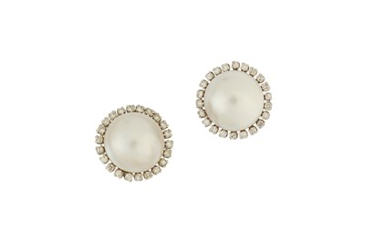 Lot 24-A pair of mabé pearl and diamond cluster earrings ...