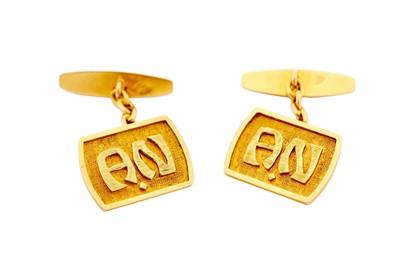 Lot 16-A pair of cufflinks, each tonneau-shaped plaque...