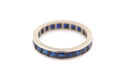 Lot 3-A sapphire eternity ring, designed as a...