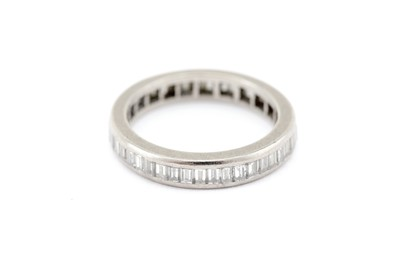 Lot 13-A diamond eternity ring, channel-set with a...