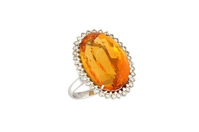 Lot 18-A citrine and diamond cluster ring The oval-cut...
