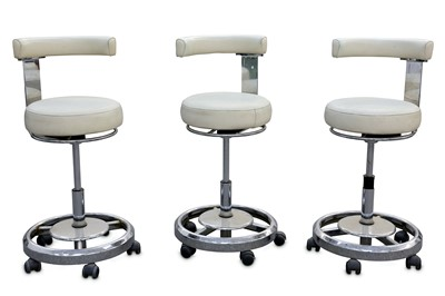 Lot 32-ITALY: A set of three Bar Stools, 1960s, white...